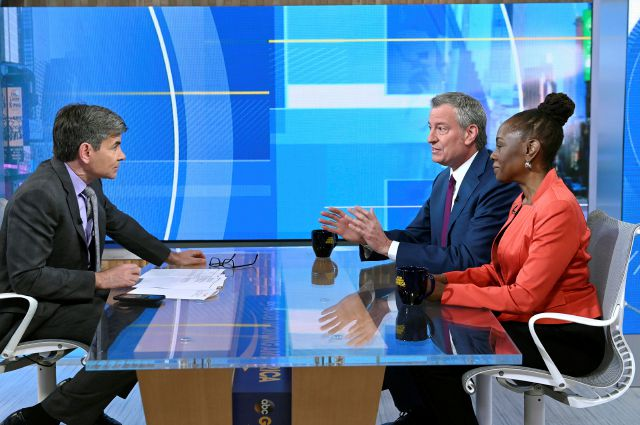 "In this photo provided by ABC, George Stephanopoulos, left, interviews New York City Mayor Bill de Blasio and his wife Chirlane McCray on""Good Morning America,"" Thursday, May 16, 2019, in New York. The mayor announced Thursday that he will seek the Democratic nomination for president, adding his name to an already long list of candidates itching for a chance to take on Donald Trump. (Paula Lobo/ABC via AP)"