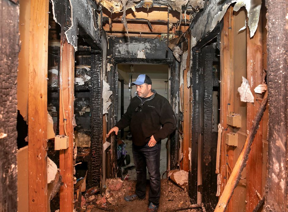 Douglas Papallo, of Wallingford, looks over the damage to a mud room and hallway after a blaze at his 7 Huelstede Ln. residence in Wallingford, Tues., Nov. 17, 2020. Papallo