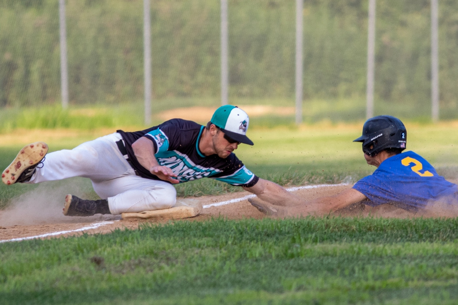 Wallingford Silver Storm's Steve Mirra is tagged out at third base by Hamden Miner's third baseman Matt Robida during the bottom of the first inning. Aaron Flaum, Record-Journal