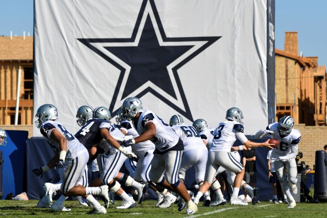 FILE - In this Monday, July 29, 2019, file photo, Dallas Cowboys practice at the NFL football team