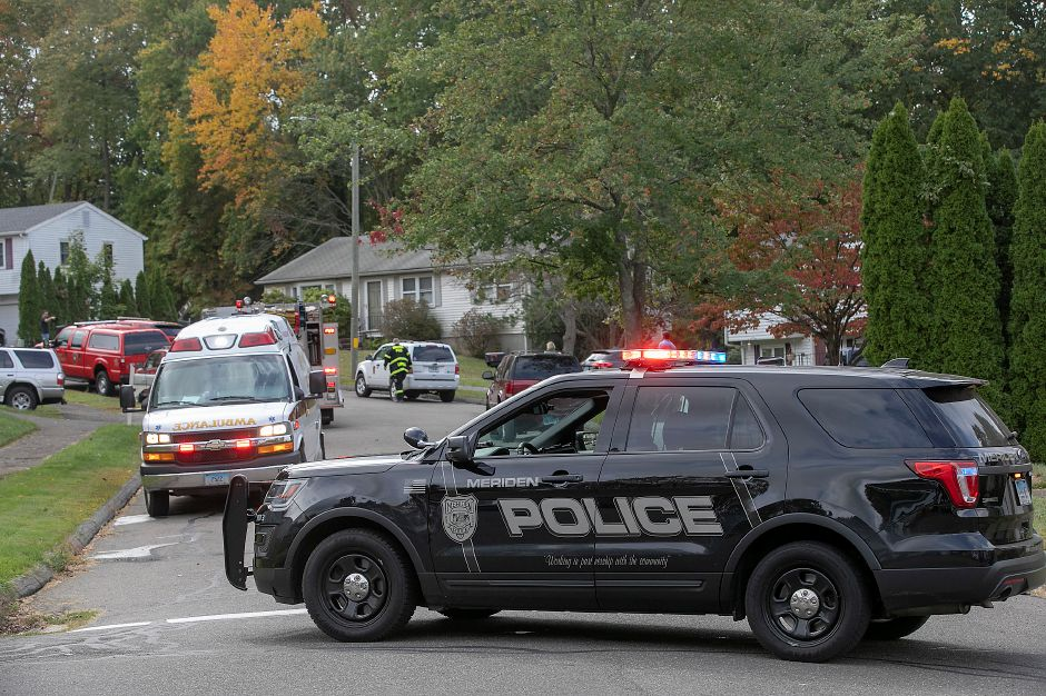 Meriden police block the road after a fire heavily damaged a residence at 32 Spice Hill Dr., Monday morning, Sept. 28, 2020. Dave Zajac, Record-Journal
