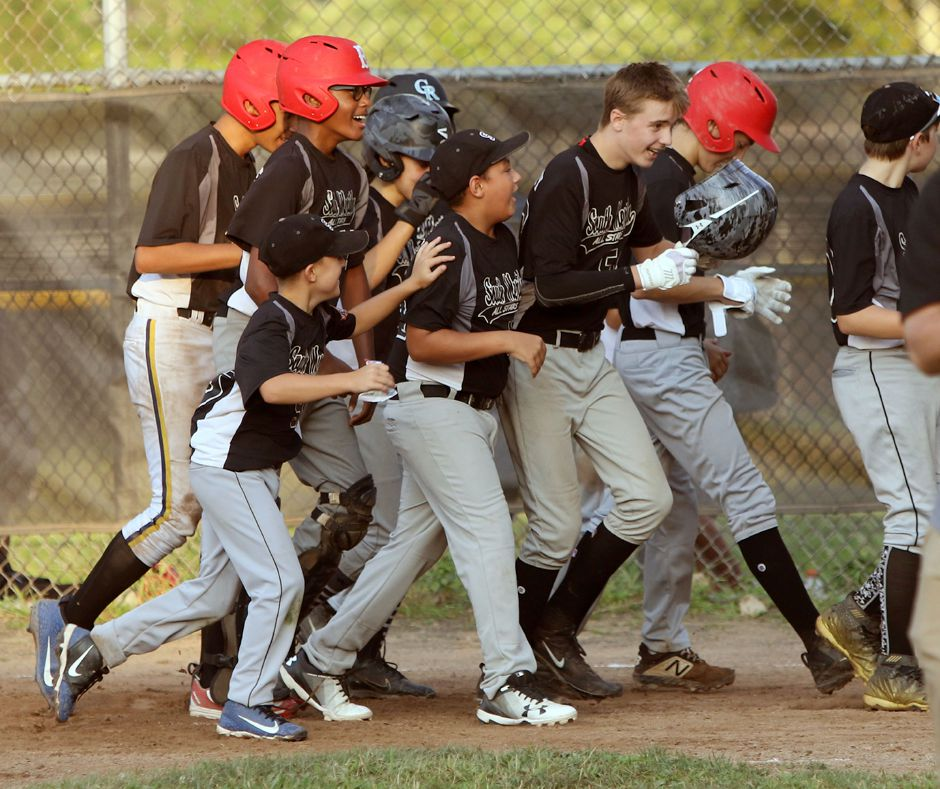 Sean Nowicky, with helmet in hand, celebrates with his South Meriden teammates after hitting a grand slam in the fourth inning against Ed Walsh during Wednesday's Meriden City Series game at Habershon Field. Aaron Flaum, Record-Journal Staff