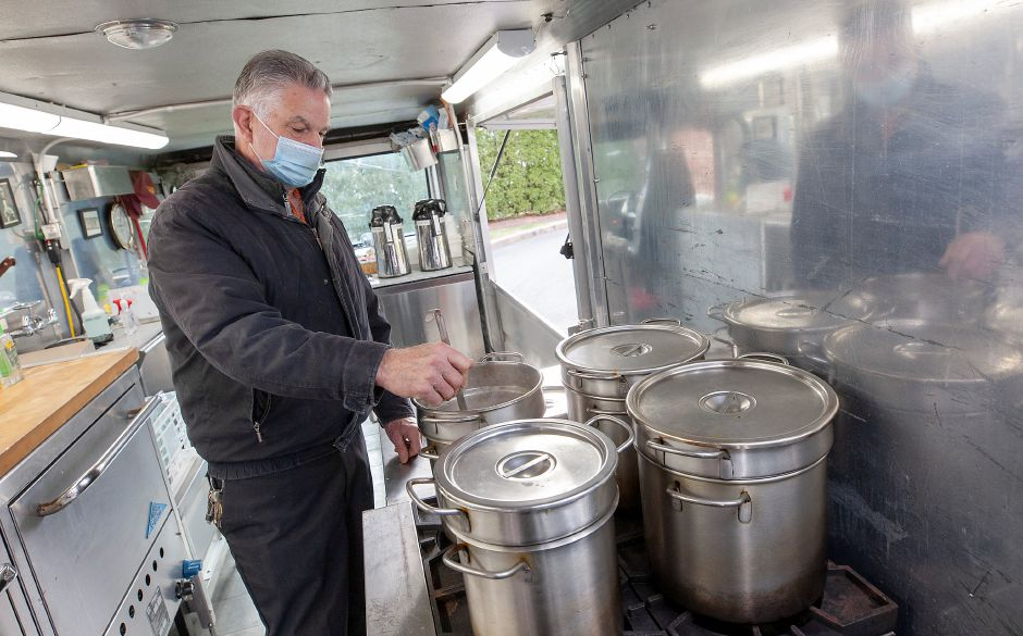 Jim Zandri stirs a pot of vegetable soup while waiting for customers in his new Zandri