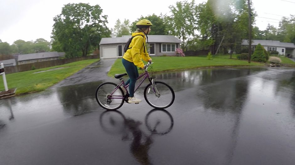 Kristen Dearborn rides her bike in the rain with a fully stocked backpack and a contingency plan for if conditions become unsafe. |Kristen Dearborn, Special to Record-Journal