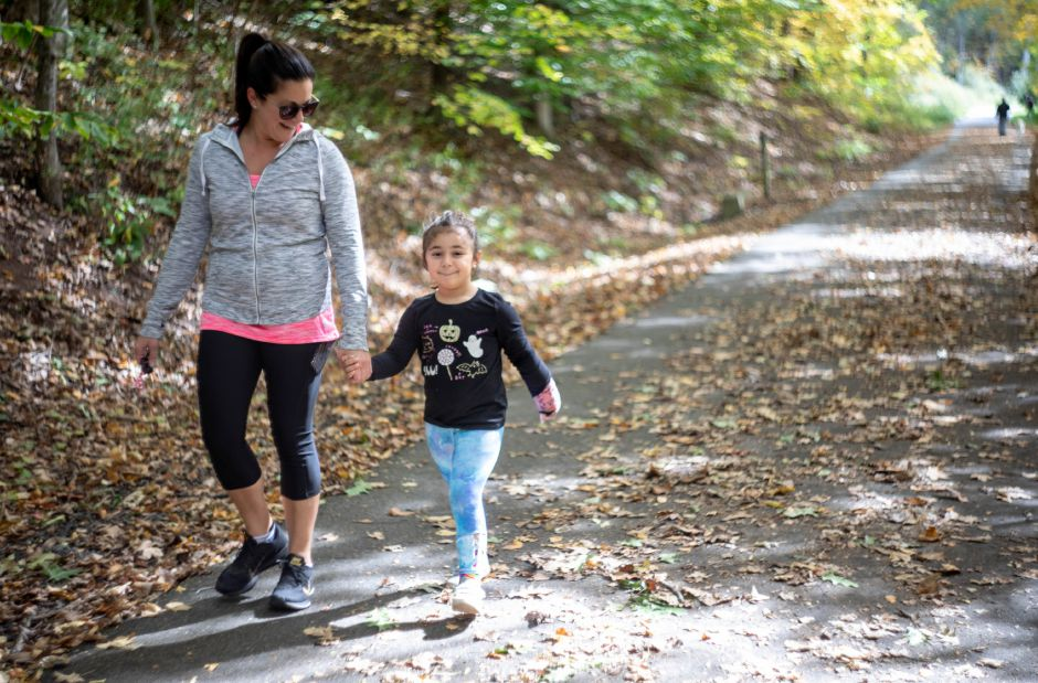 Shelly Perrotta and Quinn Rossotto, 4, walk down the Quinnipiac River Linear Trail in Meriden on Oct. 13, 2019. | Devin Leith-Yessian/Record-Journal