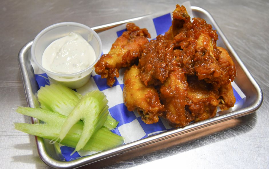 "Pigs on Wheels' ""spicy peanut butter bacon wings"" at  the Village Barn in Meriden. The new restaurant was opened by Matt Dube in October."