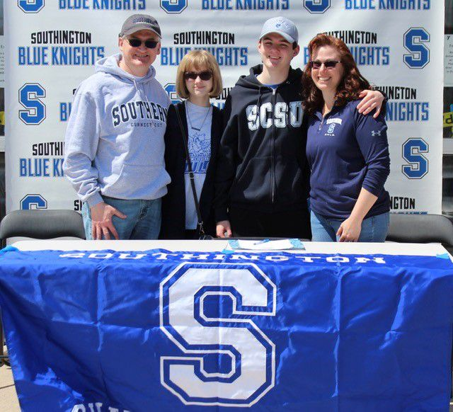 Derek Melanson, who is heading to Southern Connecticut State University, was joined at the Southington swim program's college signing ceremony at the Southington YMCA by his father Doug, sister Leighann and mother Stefanie. Photo courtesy of Evan Tuttle