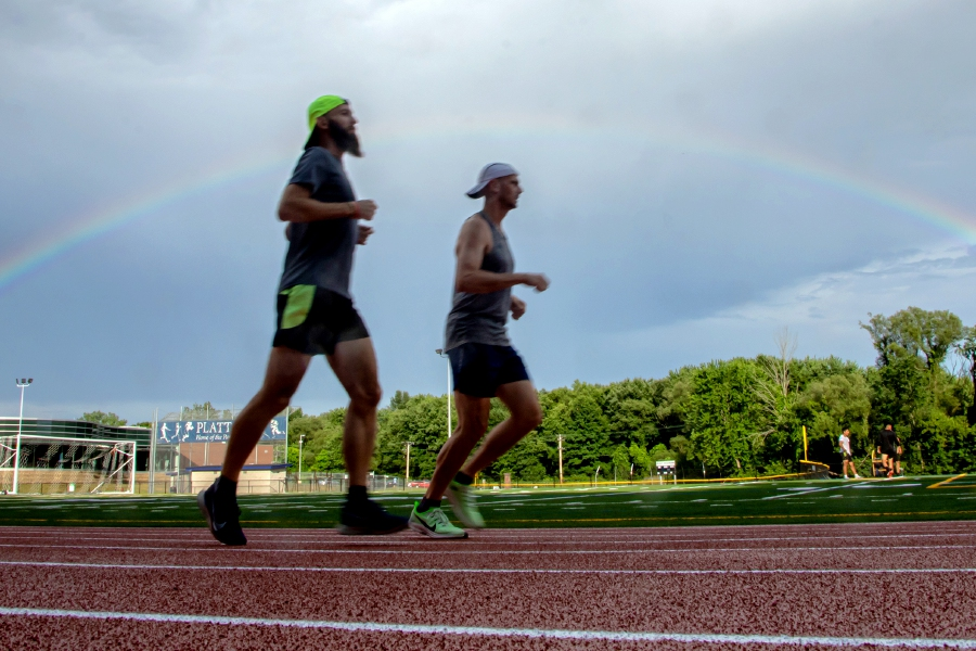 Passing showers left a rainbow as runners warmed up before the start of the three-mile Meriden  Fun Run on the track at Platt High School in Meriden on Wednesday. The fun runs will be held every Wednesday  night at 6:30 p.m. on the school's track until Aug. 19.