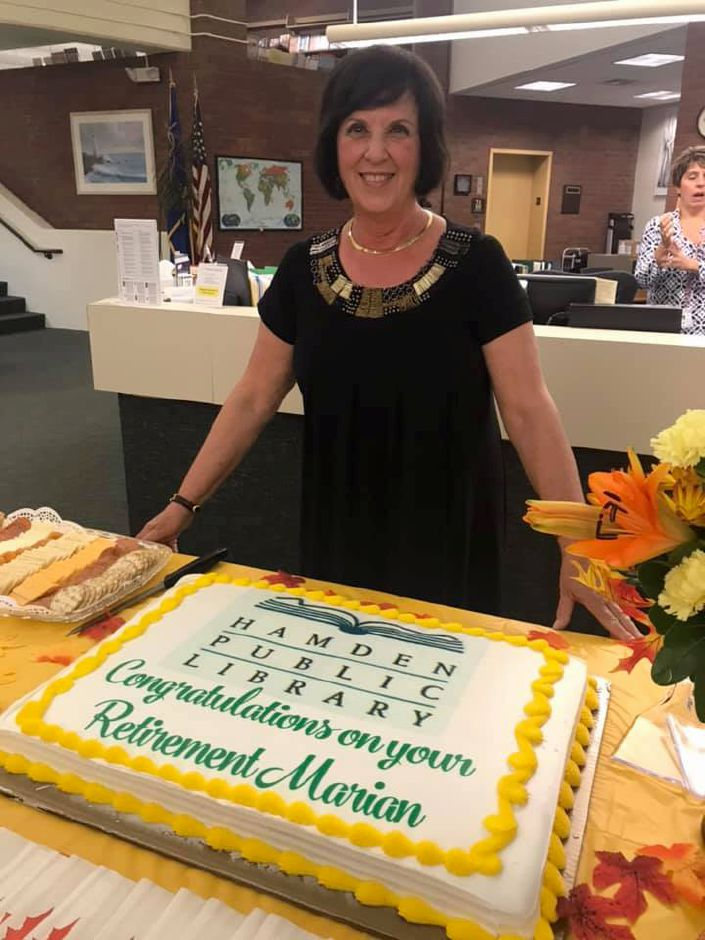 Marian Amodeo, interim director of the Meriden Public Library, is seen with a cake celebrating her retirement as Hamden's library director last September. Amodeo, a city resident, came out of retirement to fill in as interim director in Meriden after Melissa Fournier resigned. Submitted photo