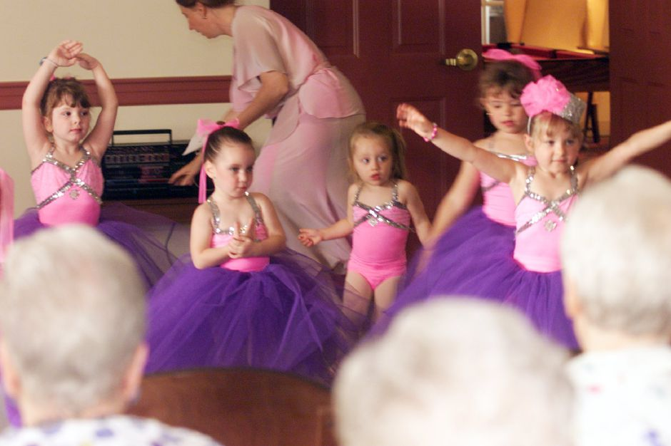 As Miss Joyce, Joyce Doty, rear, turns on the music, members of her Diaper Dappers dance class perform for residents of the Orchards Tuesday morning, June 27, 2000.
