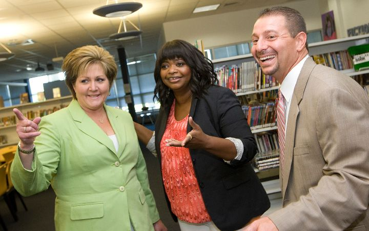 "Academy award winning actress and author, Octavia Spencer, center, shares smiles with Pamela Bahre, Board of Education member, left, and Mark Benigni, school superintendent, during an end-of-year celebration for students who read a million words throughout the year at Lincoln Middle School, Monday, June 16, 2014. Spencer is best known for her role as an outspoken maid in the 2011 film ""The Help."" 