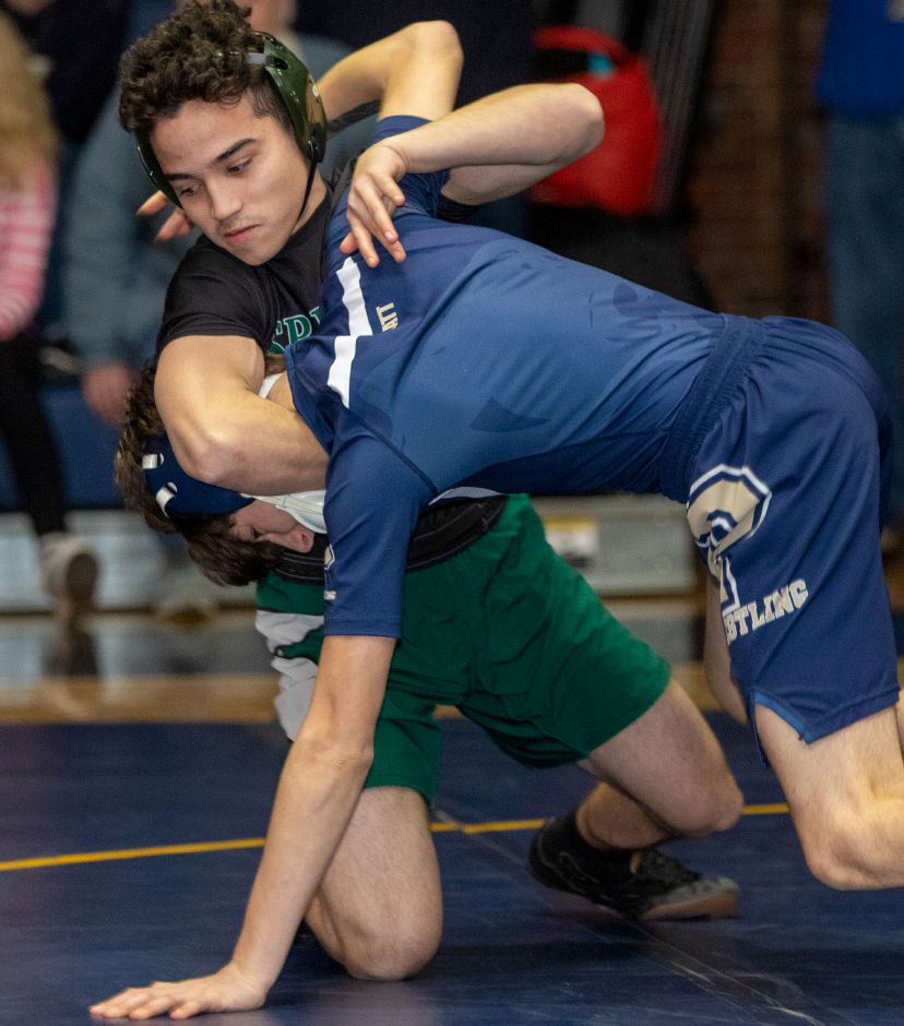 Platt's Tristen Mendoza, right,  wrestles Maloney's Onil Carrion in the 120-pound match at Platt High School in Meriden on Wednesday. Photos by Aaron Flaum, Record-Journal