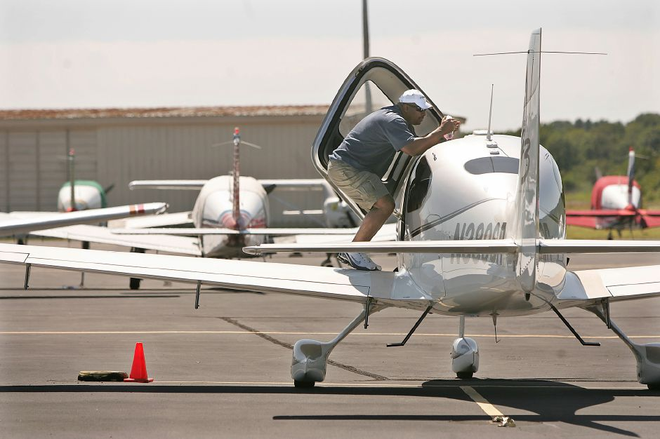 Former New York Met All Star Bobby Bonilla looks over his plane while preparing for a solo flight cross country at Meriden Markham Airport in Meriden Tuesday morning August 26, 2008. Bonilla owns the high performance single engine Cirrus SR 22 which he picked up in 2007. (dave zajac photo)