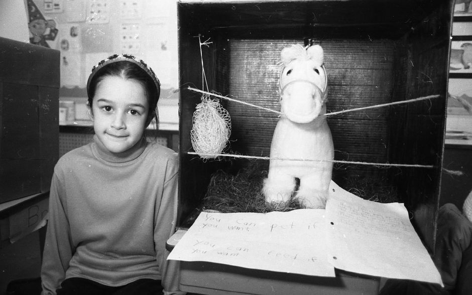 RJ file photo - Naima Montacer, 8, shows of her science project: a stall built for her toy horse, Ann. Second grade students at Rock Hill School were instructed to build appropriate environments for their toy animals as part of the class study on animals, March 1989.