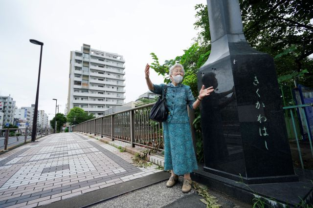 Kisako Motoki, who lost her parents and siblings to the Great Tokyo Air Raid on March 10, 1945, speaks on her war experience at Kikukawa Bridge where she escaped from air raid bombing in Tokyo Wednesday, July 29, 2020. In Japan, war orphans were punished for surviving. They were bullied. They were called trash, sometimes rounded up by police and put in cages. Some were sent to institutions or sold for labor. They were targets of abuse and discrimination. Now, 75 years after the war