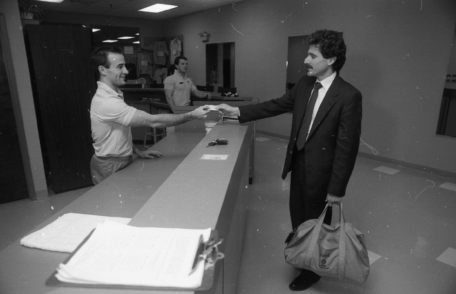 RJ file photo - Bill Hesbach, right, checks in with Corporate Physique co-owner and manager Jeff Goodwin for his daily workout, March 1989.