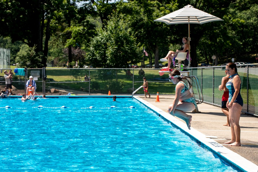 Meriden resident John Amenta swims with his granddaughter Ava Amenta, 5, at the Hubbard Park Pool in Meriden on July 5, 2020. The pool opened on July 1 as the state relaxed Coronavirus pandemic restrictions. | Devin Leith-Yessian/Record-Journal