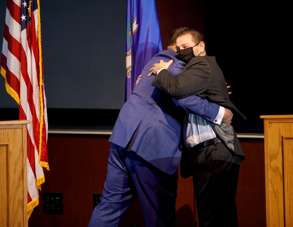 Meriden Superintendent of Schools Mark Benigni hugs Miguel Cardona, President-elect Joe Biden's choice for the next U.S. secretary of education, at the conclusion of a livestream event in the auditorium of Maloney High School in Meriden, Mon., Jan. 11, 2021. Dave Zajac, Record-Journal
