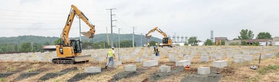 Crews position concrete blocks as construction continues on a solar farm off Ball and South Cherry streets in Wallingford, Fri., Jun. 5, 2020. Dave Zajac, Record-Journal