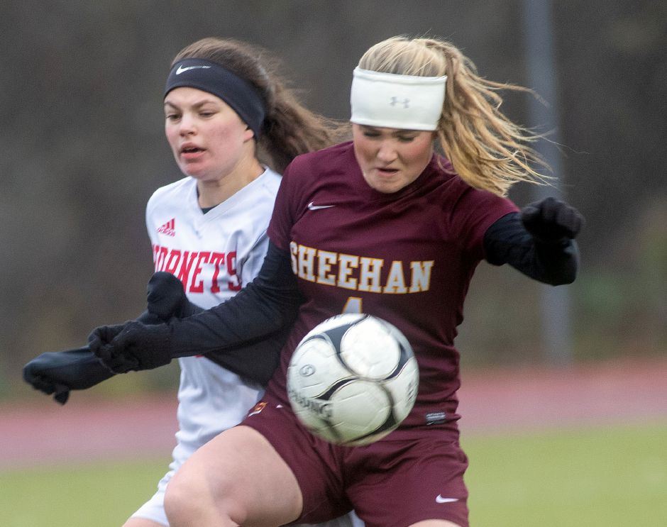 Sheehan's Bethany Gray beats Branford's Kathryn Amarante to the ball.