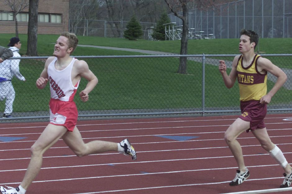 Eric Ljungquist, left, from Cheshire High School, stays in the lead as he heads towards the finish line of the mens 800 meter dash April 20, 2001. On the right is Johnathan Butler from Lyman Hall. Ljungquist finished first and Butler came in second. The track meet was at Platt High School in Meriden.