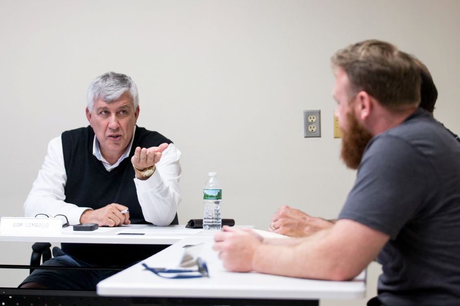 FILE PHOTO – Board of Finance Chairperson Sam Lomaglio speaks to member Kevin Guite at the a board meeting. | Devin Leith-Yessian/Berlin Citizen