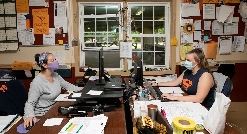 Sarah Dupre, outdoor center administrator, left, and Rachel Lyles, trail blazer director, work at their desks at Camp Sloper in Southington, Fri., May 22, 2020. Camp Sloper will operate their on site programs this summer, though with strict guidelines in order to keep their staff and campers healthy and safe. Dave Zajac, Record-Journal