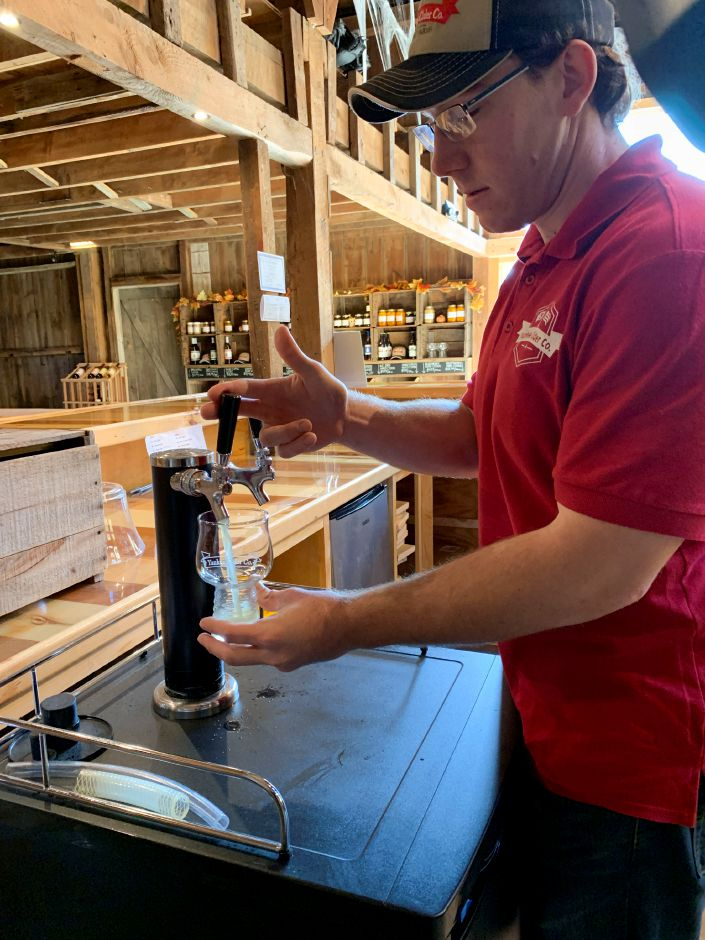 "Co-owner Kevin Staehley pours a glass of ""Best of Both"" cider in the Yankee Cider Co."