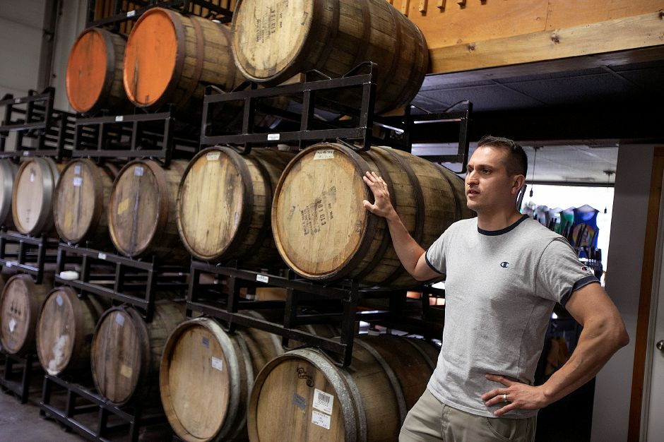 Miguel Galarraga, of Hamden, co-owner of New England Cider Company, talks about the business located at 110 N. Plains Industrial Rd. in Wallingford, Wed., July 17, 2019. The business is seeking to expand in its current space. Dave Zajac, Record-Journal