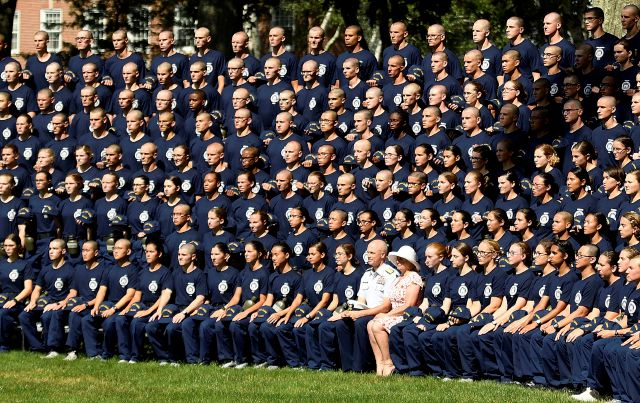 FILE - In a Monday, July 1, 2019 file photo, U.S. Coast Guard Academy Superintendent Rear Adm. William G. Kelly and his wife Angie pose with the Class of 2023 for their class photo on Day One of Swab Summer in New London, Conn. The Department of Homeland Security's inspector general says the U.S. Coast Guard Academy has failed to properly investigate and handle allegations of racial harassment, including the use of racial slurs by cadets. (Sean D. Elliot/The Day via AP, File)