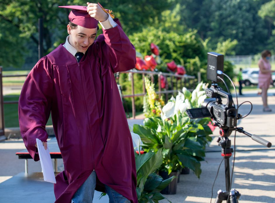 Sheehan graduate Jacob Smolenski turns his tassel for the camera after he received his diploma on Tuesday during a drive up graduation at the school. Aaron Flaum, Record-Journal