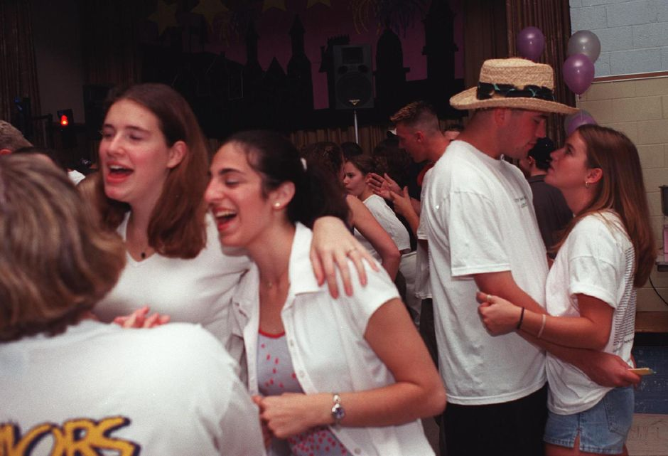 Jenn Wisniewski and Ty Bonjiovanni share a quiet moment amist the loud music and dancing Thursday night at Project Graduation, a party for graduates of Maloney, Platt, and Wilcox June 20, 2000.