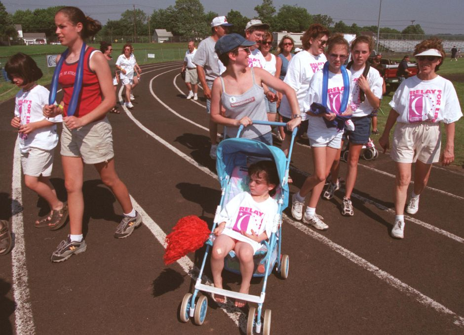 Lori Cochrane of Southington, pushes her 4 year old daughter Brooke Cochrane around the track at Southington High School during the Relay for Life event Saturday June 10, 2000.
