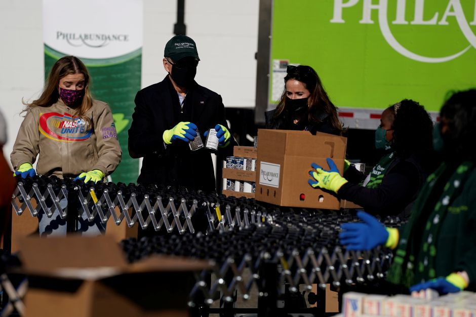 President-elect Joe Biden participates in a National Day of Service event at Philabundance, a hunger relief organization, with his daughter Ashley Biden, and his granddaughter Finnegan Biden, left, Monday, Jan. 18, 2021, in Philadelphia. (AP Photo/Evan Vucci)