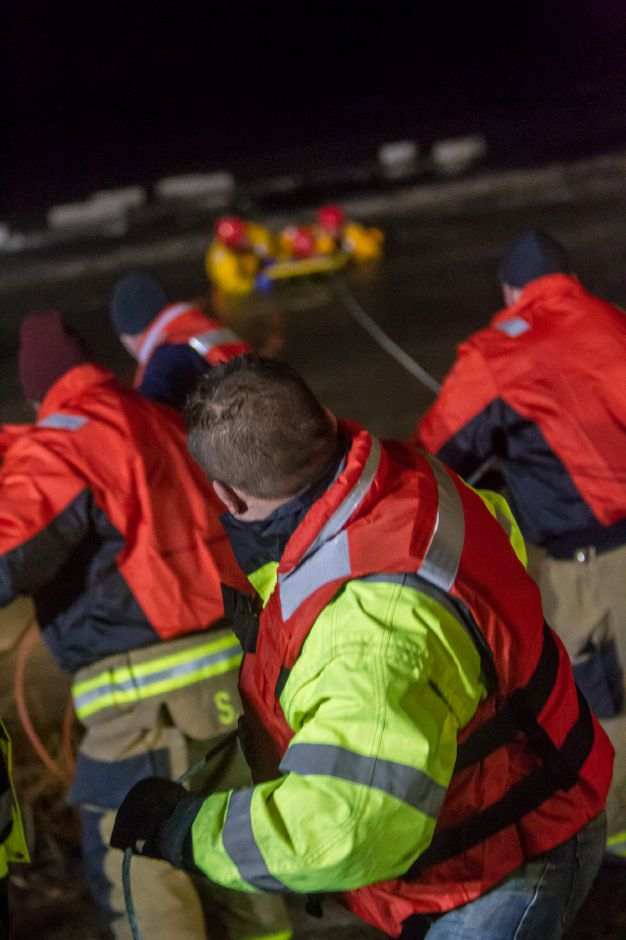 Berlin and Kensington firefighters look on during Cold Water Training Monday night Feb. 4, 2019. | Ron Paris, Special to the Record-Journal