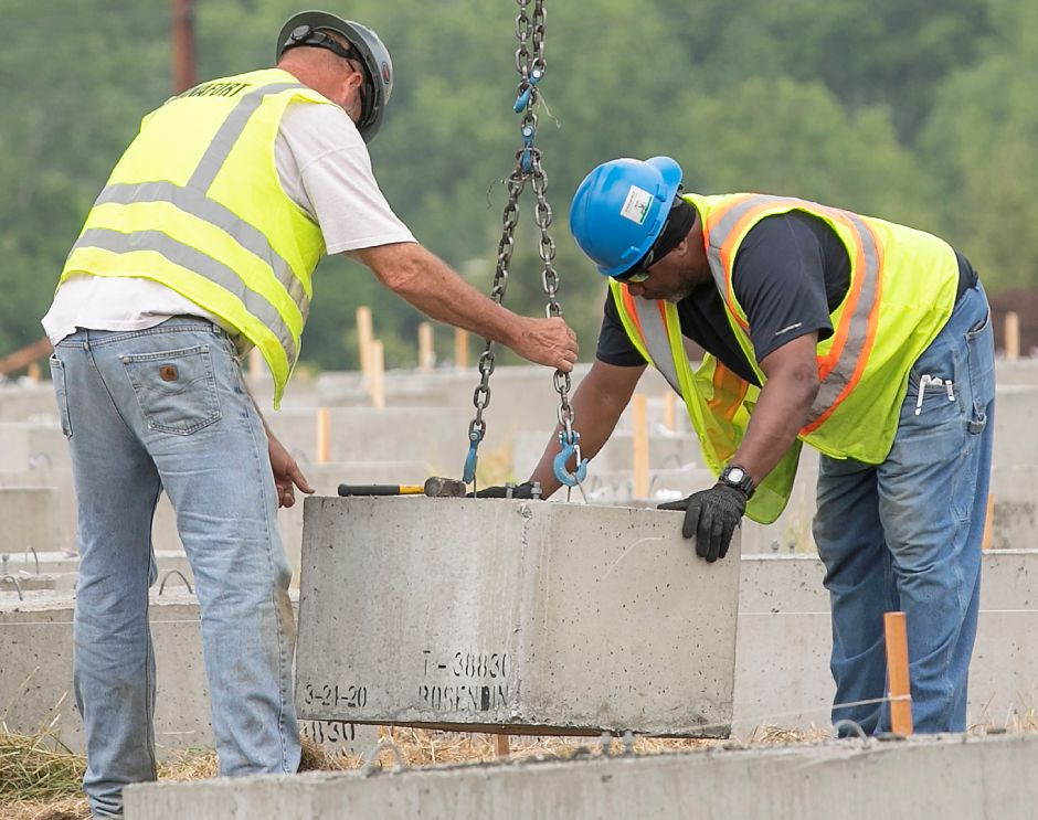 Crews position concrete blocks in place as construction continues on a solar farm off Ball and South Cherry streets in Wallingford, Fri., Jun. 5, 2020. Dave Zajac, Record-Journal