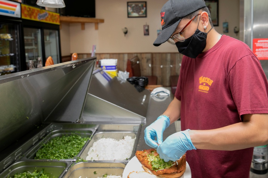 Cook Ivan Estrada prepares a sandwich at Tacos Mi Nacho, 550 Broad St., Meriden, Thurs., Sept. 17, 2020. Tacos Mi Nacho is opening a second location at 1796 Meriden-Waterbury Tpke. in Southingtion. Dave Zajac, Record-Journal