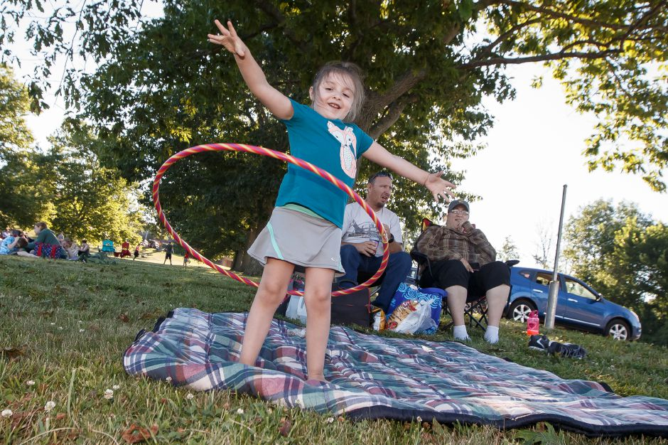 Kaitlyn Morrison 4 tries her hula hoop out with mom Sharon and dad Jason Saturday during the Wallingford Fireworks display at Sheehan High School in Wallingford July 7, 2018 | Justin Weekes / Special to the Record-Journal