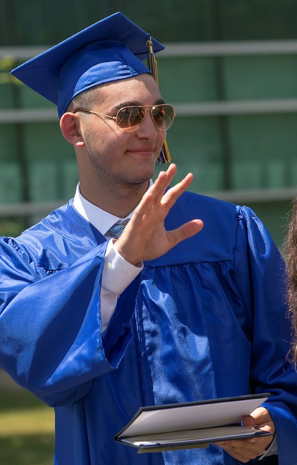 Electronics graduate Ryan Pellegrino waves after receiving his diploma during graduation ceremonies at H.C. Wilcox Technical High School in Meriden, Mon., Jun. 22, 2020. Dave Zajac, Record-Journal
