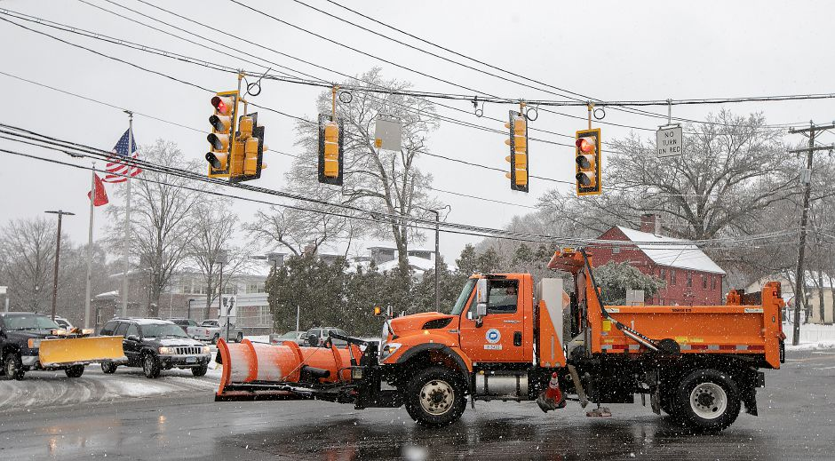 A State snowplow travels through the intersection of West Main Street and Chamberlain Highway in Meriden, Mon., Dec. 2, 2019. Dave Zajac, Record-Journal