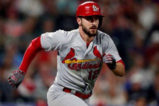 "FILE - In this Sept. 10, 2019, file photo, St. Louis Cardinals shortstop Paul DeJong (12)  runs the bases in the ninth inning of a baseball game against the St. Louis Cardinals in Denver. Reporters from The Associated Press spoke to more than two dozen athletes from around the globe -- representing seven countries and 11 sports -- to get a sense of how concerned or confident they are about resuming competition. Some wondered whether they would agree to receive a COVID-19 vaccine if required by their sport eventually.  ""I think it would stop at some sort of vaccine to play,"" St. Louis Cardinals All-Star shortstop Paul DeJong said. ""There is a fine line between what (MLB) can do to protect us and some things they can do to kind of exert power over us.""(AP Photo/David Zalubowski, File)"