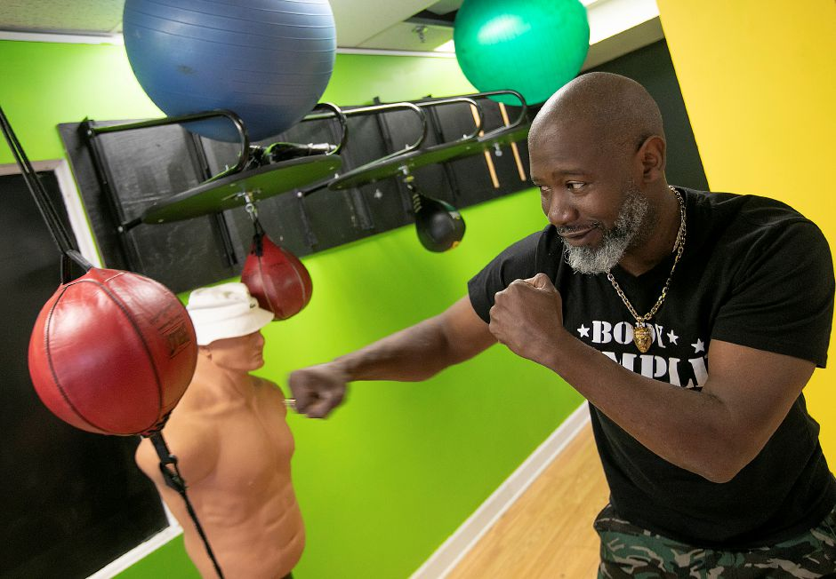 Terrace Johnson, owner of Body Temple Fitness, lands a few punches on a reflex bag at the 20 N. Plains Industrial Rd. business in Wallingford, Thurs., Oct. 10, 2019. Body Temple Fitness is celebrating 10 years in Wallingford. Dave Zajac, Record-Journal