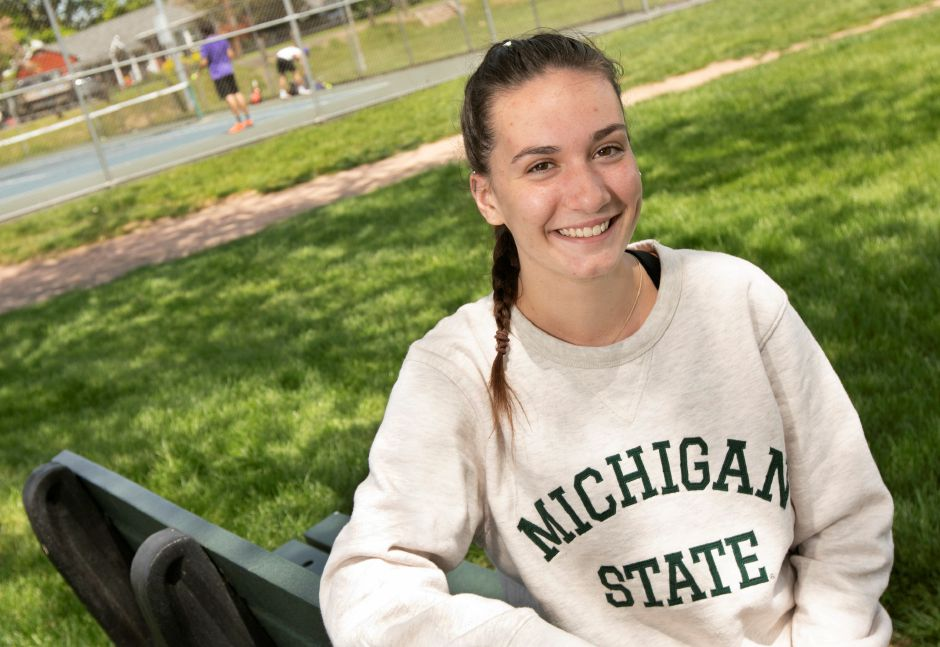 Sheehan High School student Gracie Waldron, 18, smiles on a break from playing tennis with friends last week at Doolittle Park in Wallingford. Waldron will be attending Michigan State University after the summer break. Dave Zajac, Record-Journal