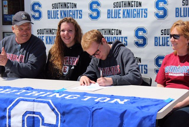 Southington swimmer Kyle Buchanan finalizes his commitment to Eastern Connecticut State University alongside his parents Paul and Sue Buchanan. At Eastern, Kyle Buchanan will join his sister Kerry, who sits on his immediate right. | Photo courtesy of Evan Tuttle
