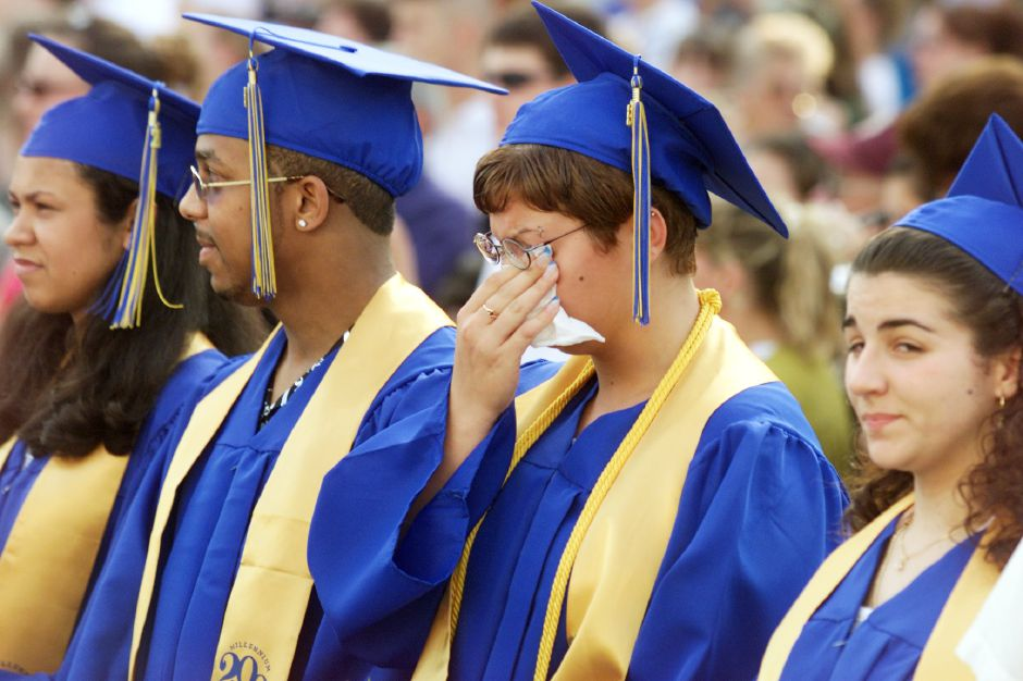 Wilcox Tech Class President Cassandra Mason, second from right, wipes away tears Friday, June 16, 2000 during graduation ceremonies. Her Drafting classmates are Jennifer Raspardo, left, Andre Ortiz, second from left, and Michele Caldeira, right.