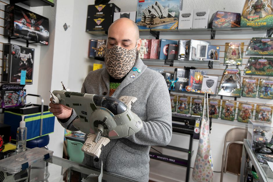 Robert Torres, owner of This Toy Life, holds his favorite Star Wars collectible, Boba Fett