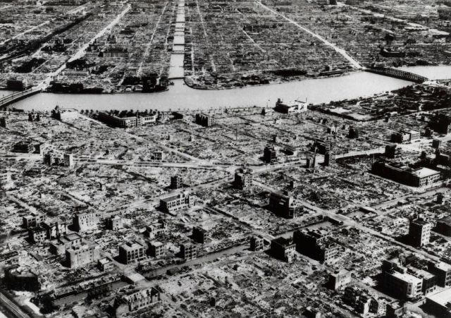 FILE - This aerial photo taken in March 9, 1945 shows the industrial section of Tokyo along the Sumida River. The nuclear bombs dropped by the United States on Hiroshima and Nagasaki in Aug. 1945 secured Japan