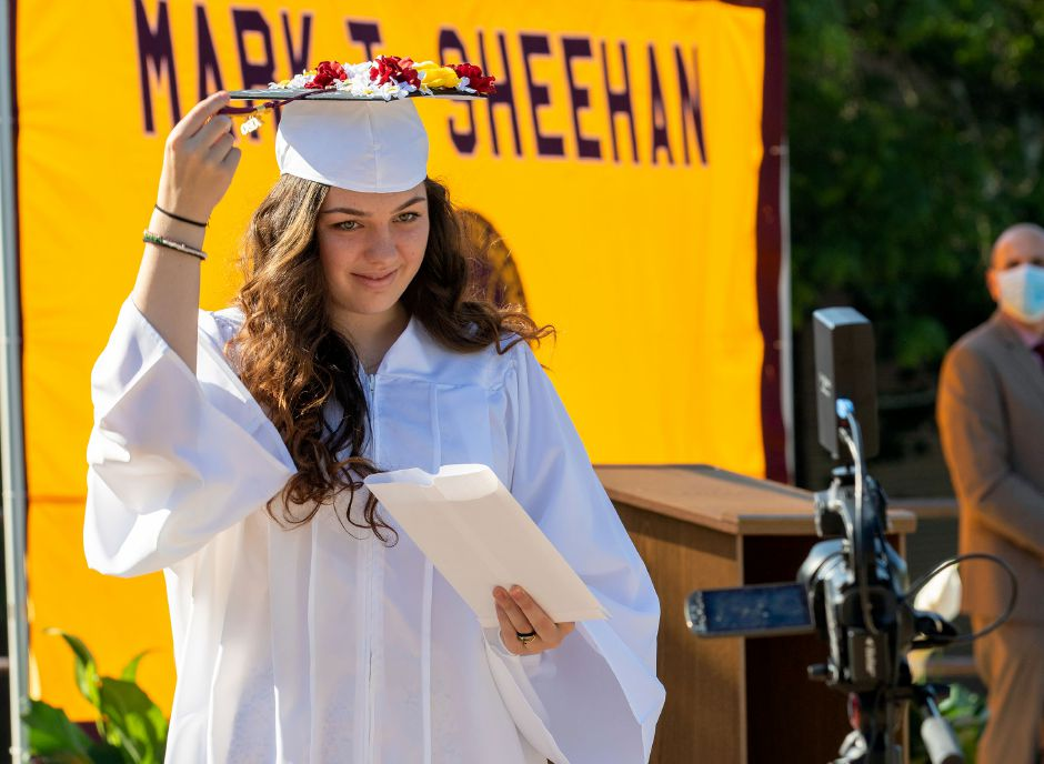 Sheehan graduate Olivia Fonteyn turns her tassel after she received her diploma on Tuesday, June 23, 2020, during a drive up graduation at the school. Aaron Flaum. Record-Journal