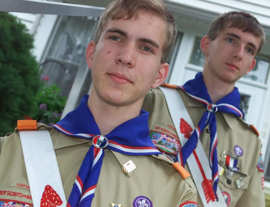 Stan Kostka, left, and his brother Luke Kostka, stand in front of their Newton Street home in Meriden. The brothers recently received the Eagle Scout award from the Boy Scouts of America - June 2000