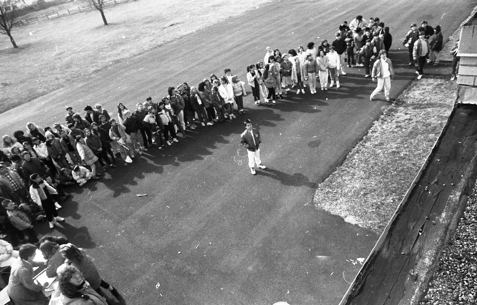 RJ file photo - Cook Hill School students watch eggs get dropped from the roof as part of a project to design a container to protect eggs from the fall, March 1989.